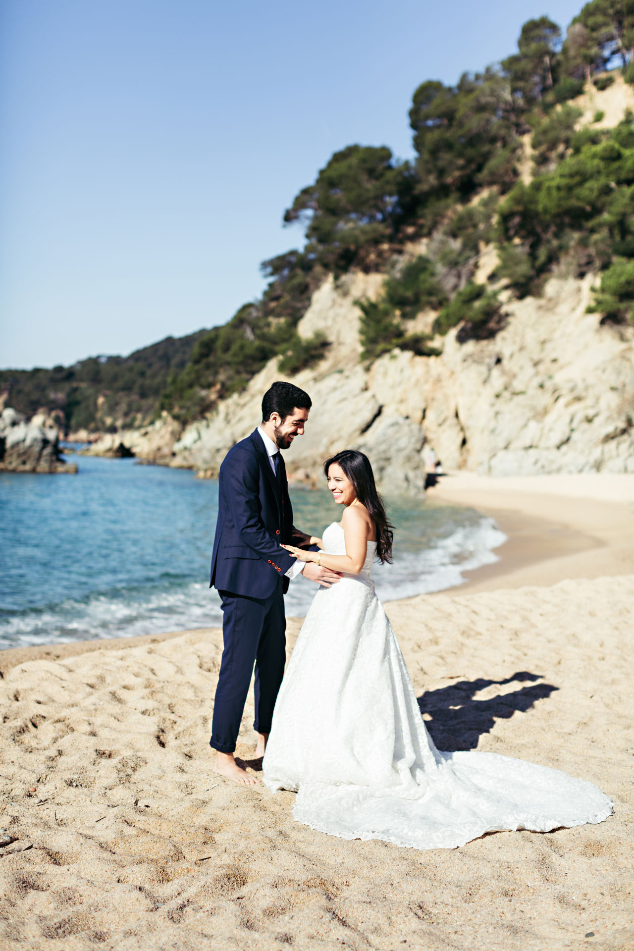 Beach Bonding Bride Bridegroom Celebration Day Full Length Happiness Husband Life Events Love Married Men Nature Real People Romance Togetherness Two People Wedding Wedding Dress Wife Women Young Adult Young Men Young Women