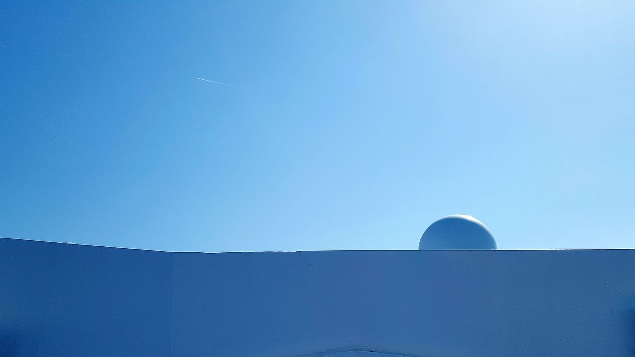blue, copy space, clear sky, built structure, architecture, low angle view, no people, day, outdoors, building exterior, moon, nature, beauty in nature, sky, astronomy