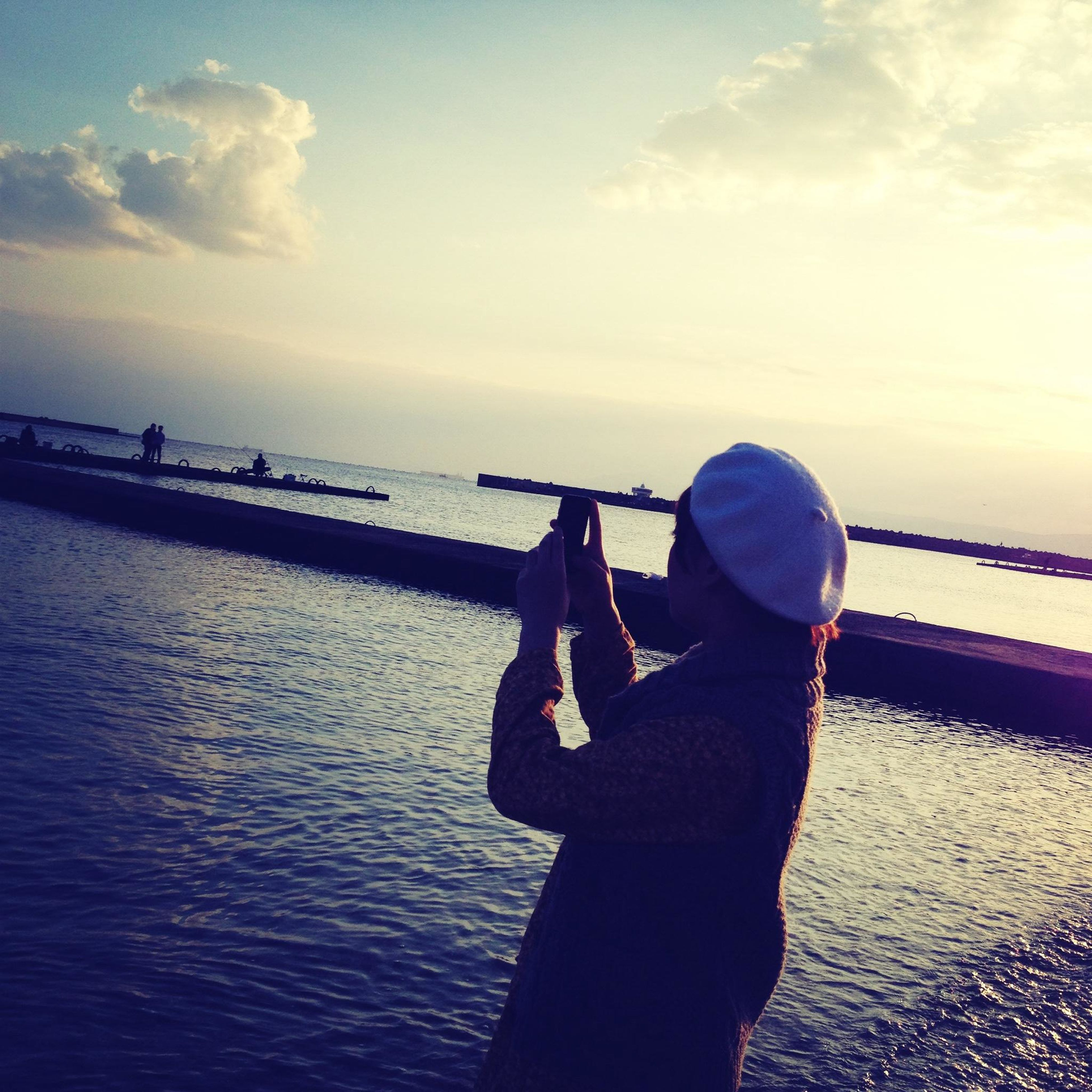 sea, water, sky, lifestyles, leisure activity, rear view, men, horizon over water, cloud - sky, railing, standing, cloud, transportation, nautical vessel, full length, pier, nature