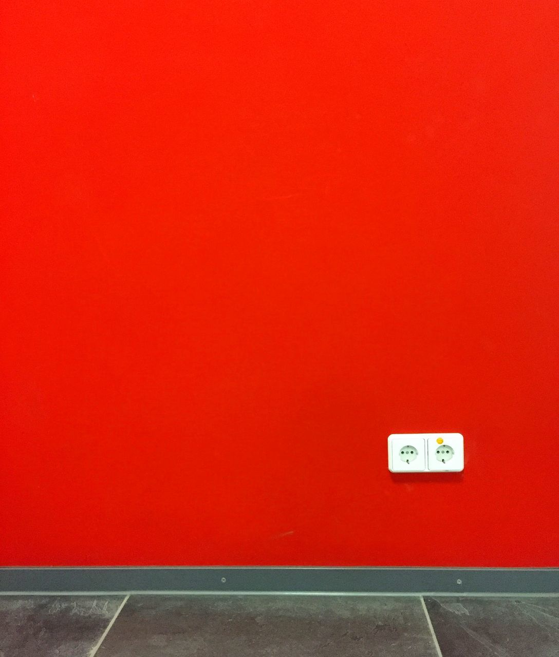 Light Switch On Red Wall At Home