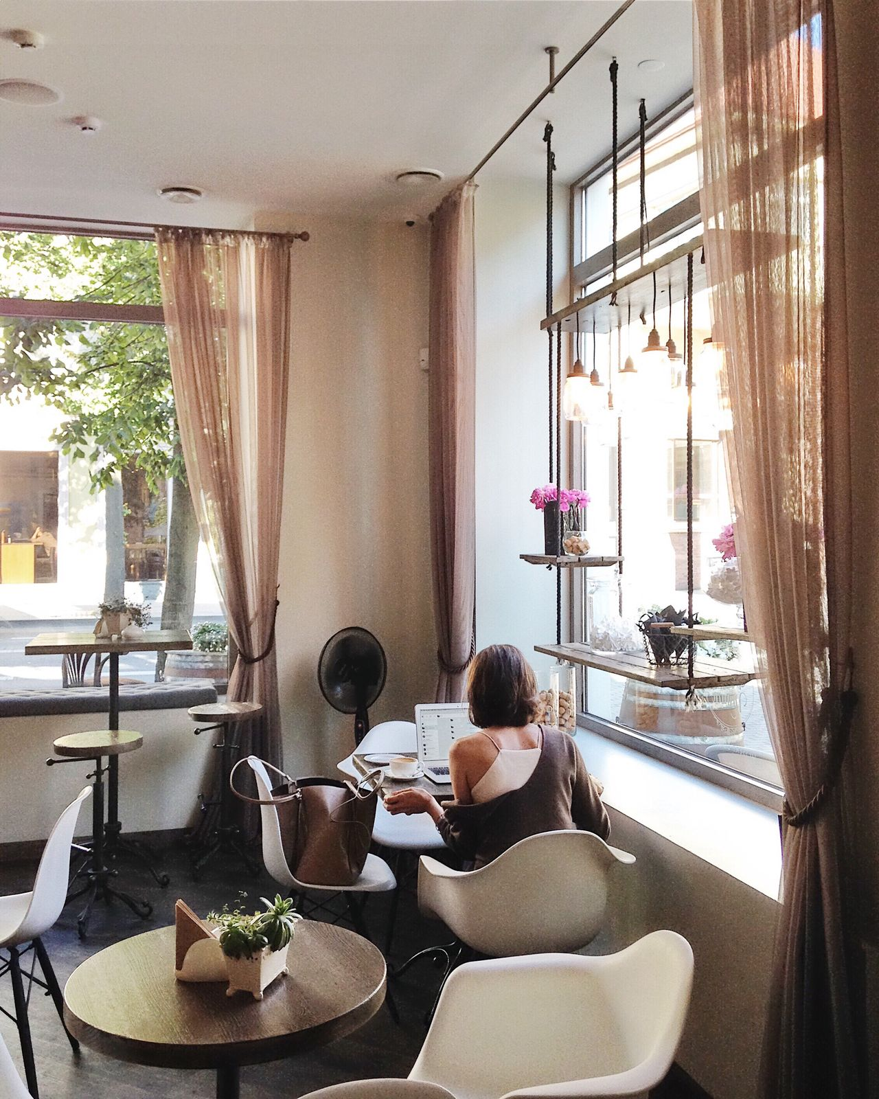 Woman working in the coffee shop Coffee Directly Above Creativity Window Indoors  One Person One Woman Only Domestic Room Home Interior Only Women Sitting Using Laptop Adults Only Design