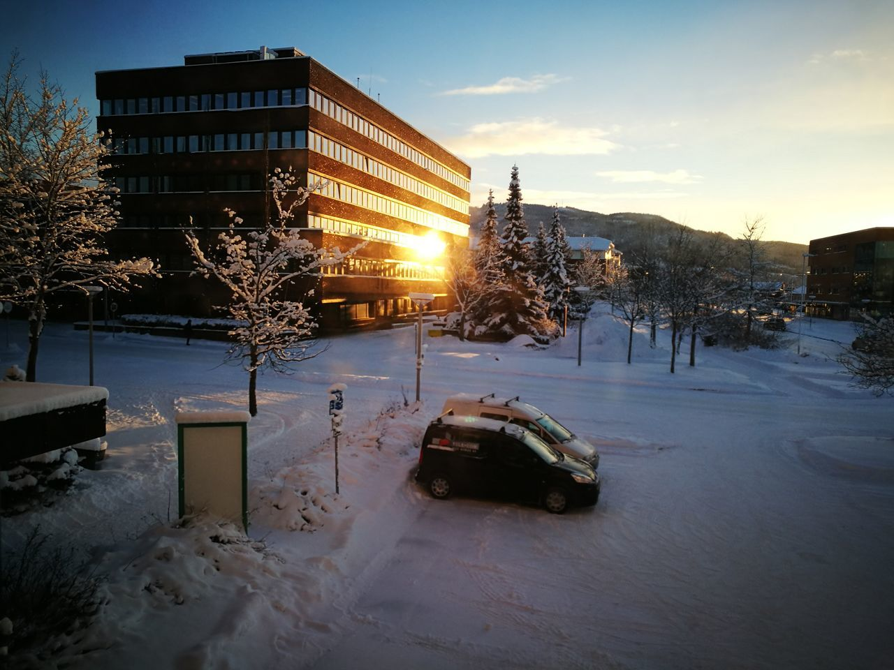 Steinkjer City Hall on fire my setting winter sun. Winter Snow Car City Reflection Cold Temperature Illuminated Sunset No People Architecture Tree Outdoors Day Building Exterior Built Structure City Architecture Sky On Fire Winter Golden