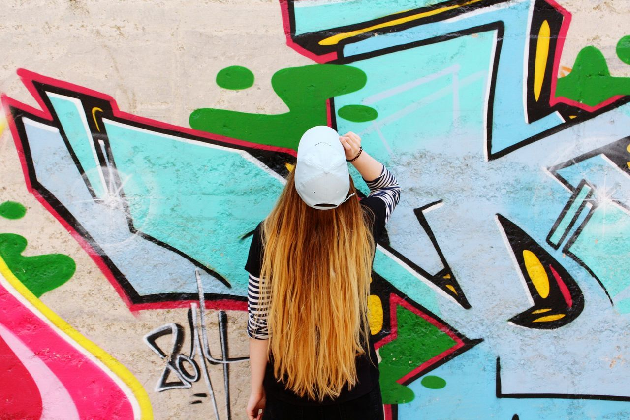 Graffiti Creativity Built Structure Street Art One Person Architecture Outdoors One Woman Only Summertime Summer Happiness Fun Goofy Summer Lost Places Lostplaces Long Hair One Young Woman Only Architecture Cap Baseball Cap Destroyed Building