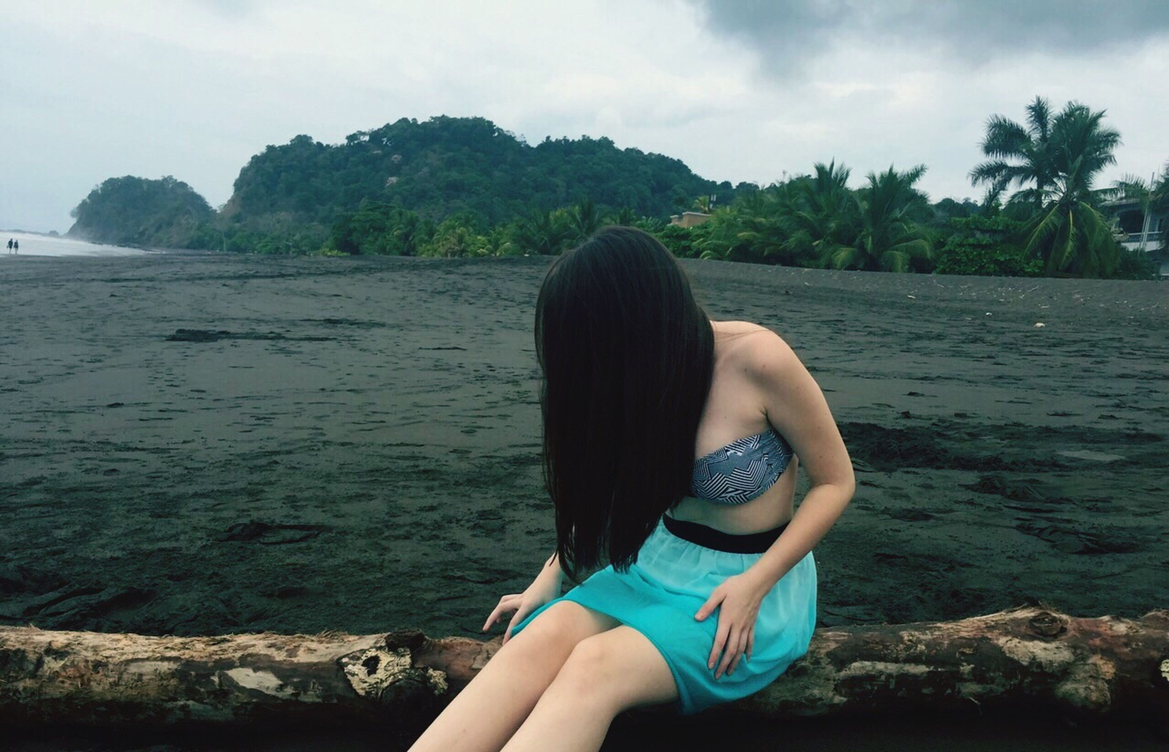 water, sea, sky, lifestyles, leisure activity, person, rear view, beach, tranquility, tranquil scene, tree, long hair, vacations, scenics, relaxation, nature, beauty in nature, young women