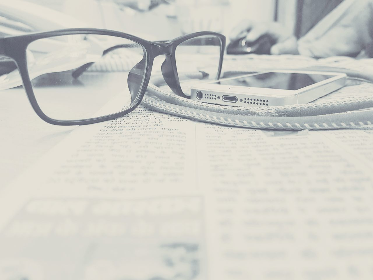 newspaper, eyeglasses, text, table, the media, no people, indoors, education, paper, close-up, business, day