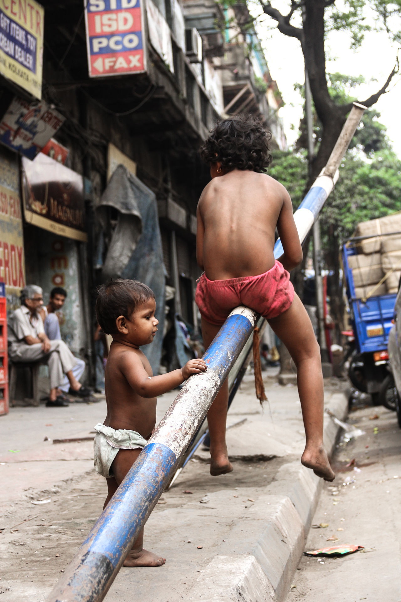children playing Children Day Innocence Outdoors People Real People Rough Life Streets Two People The Photojournalist - 2017 EyeEm Awards The Street Photographer - 2017 EyeEm Awards