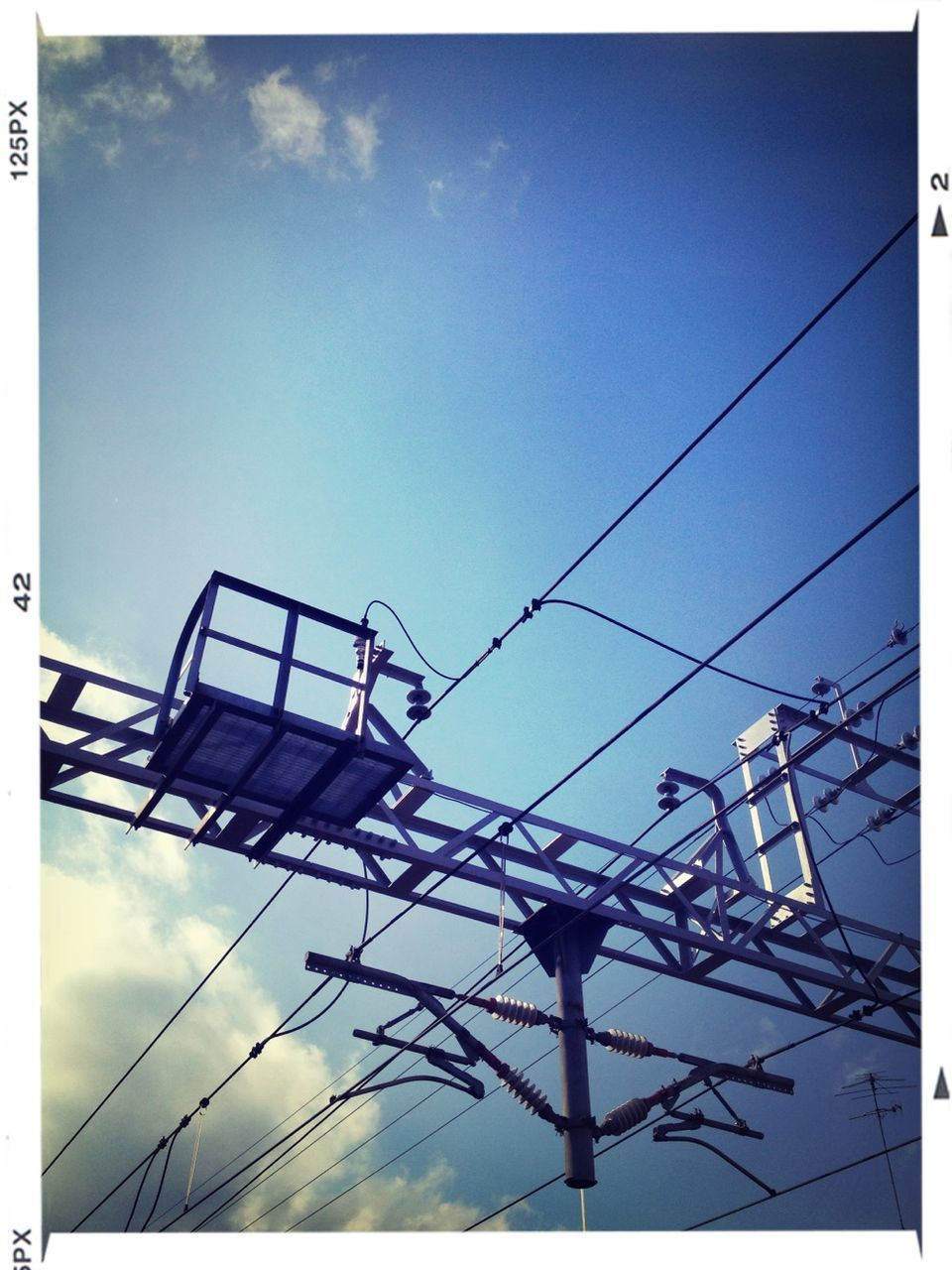 low angle view, auto post production filter, cable, day, sky, outdoors, no people, built structure, architecture, building exterior, electricity pylon