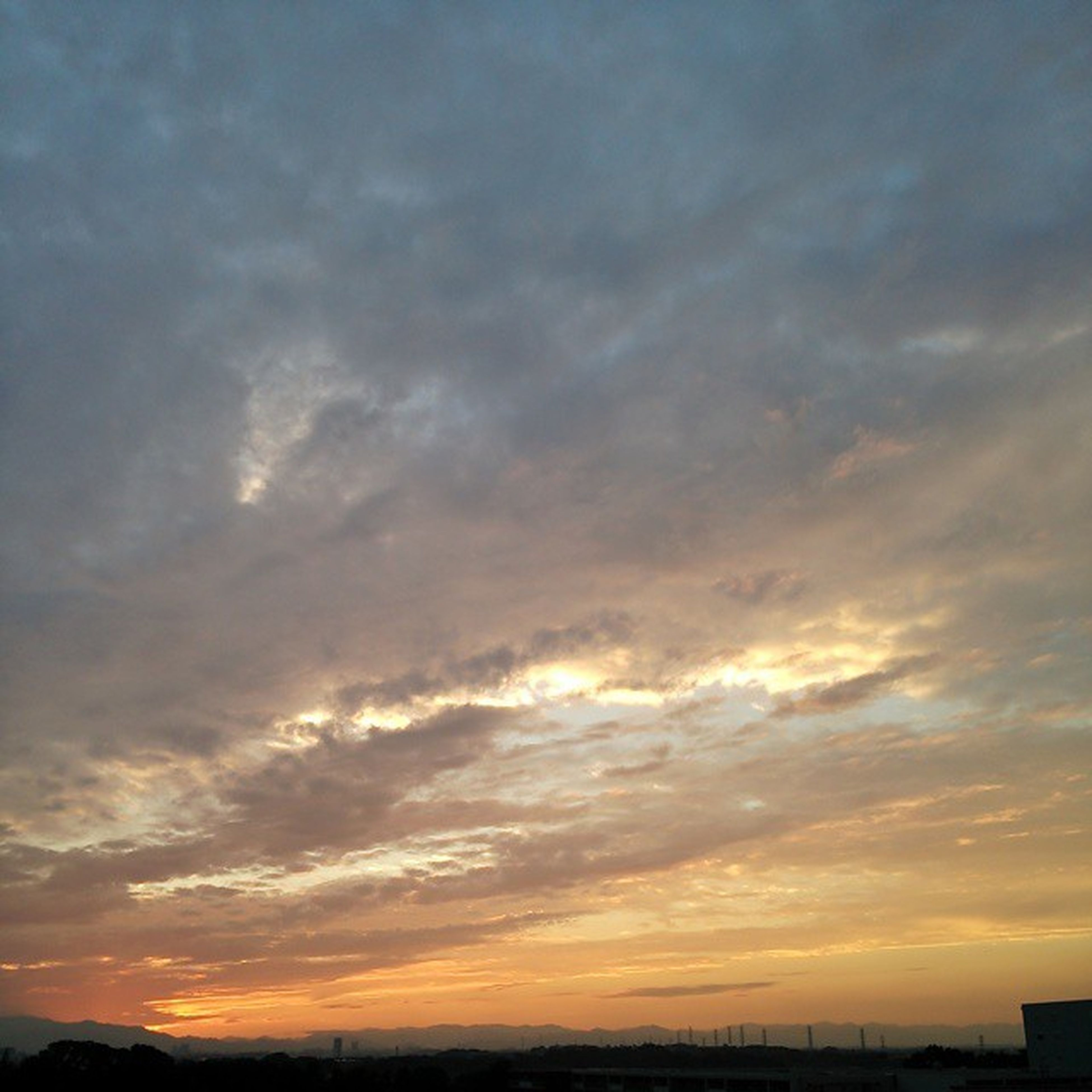 sunset, sky, scenics, tranquil scene, beauty in nature, tranquility, silhouette, cloud - sky, orange color, nature, idyllic, dramatic sky, landscape, cloud, cloudy, moody sky, outdoors, weather, no people, majestic