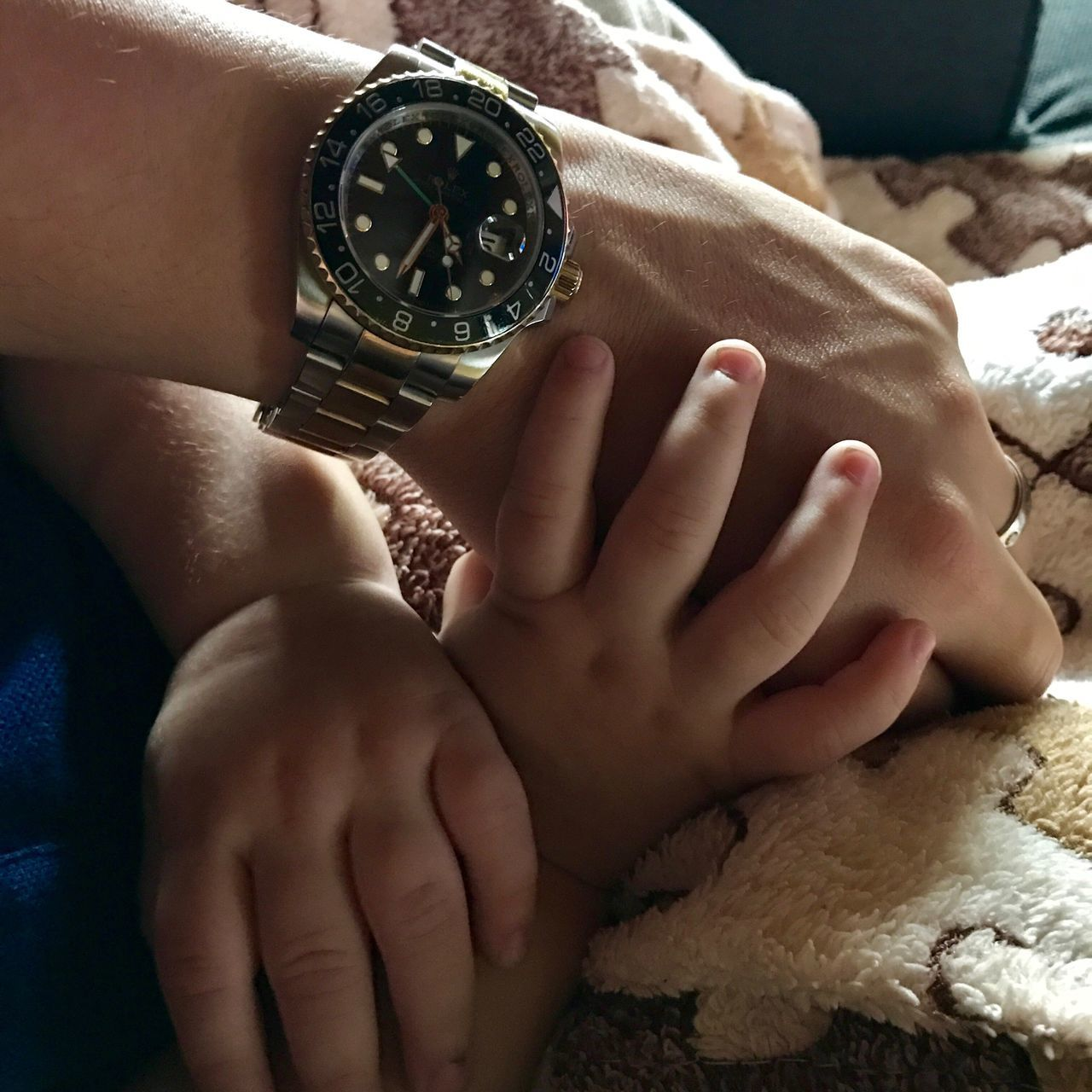 time, human hand, real people, human body part, childhood, togetherness, bed, indoors, close-up, women, bonding, clock, day, adult, people
