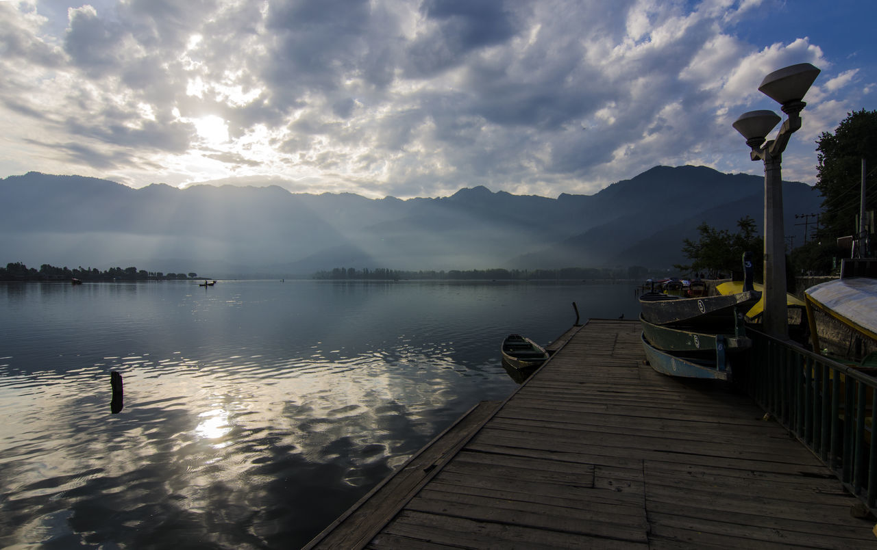 Beauty In Nature Cloud - Sky Dal Lake Dal Lake, Srinagar Day Extreme Weather Lake Landscape Mountain Nature Nautical Vessel No People Outdoors Pier Reflection Scenics Sky Srinagar Kashmir Sunrise Tranquility Water Wood - Material