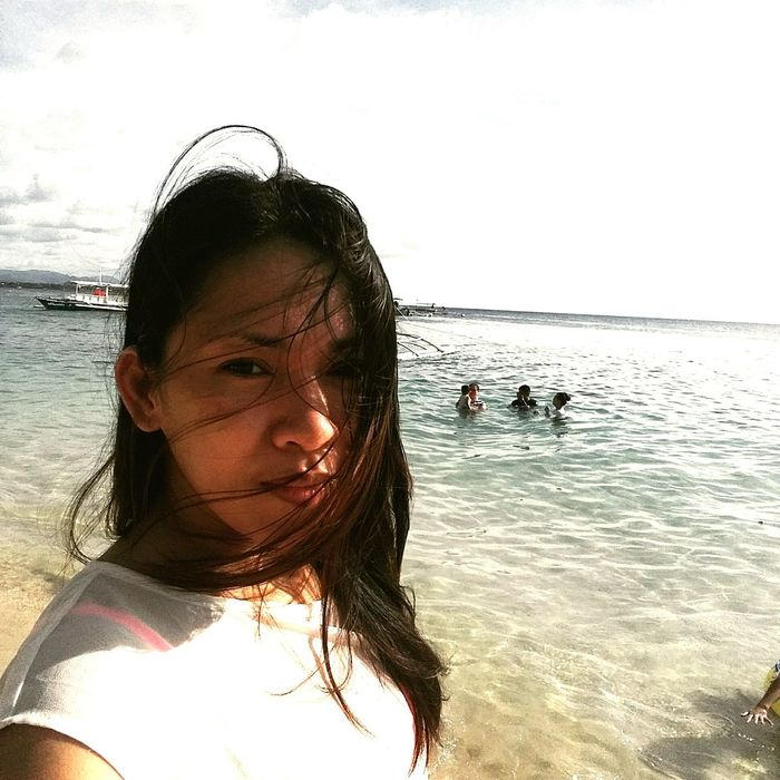 Sea Beach Water Vacations Adult Summertime Front View One Person Looking At Camera AyeEm Philippines  Black Hair One Woman Only Mobile Conversations One Girl Only