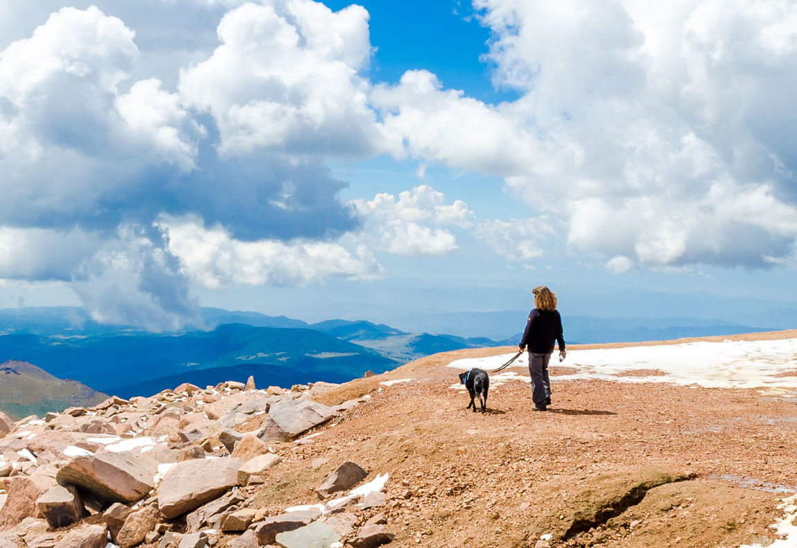 Beauty In Nature Blue Cloud Cloud - Sky Cloudy Companion Dog Day Escapism Full Length Lady With Dog Majestic Mountain Mountain Range Nature Non-urban Scene Outdoors Remote Scenics Sky Solitude Summer Sunny Tranquil Scene Tranquility Two Is Better Than One