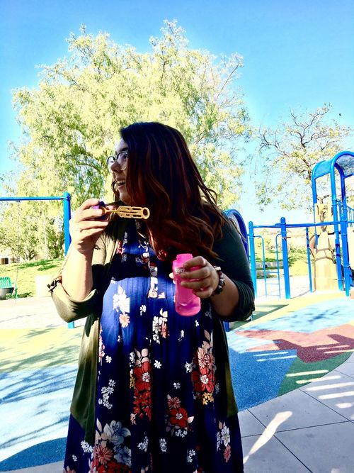 One Person Real People Long Hair Casual Clothing Young Women Day Leisure Activity Front View Lifestyles Young Adult Holding Sunlight Outdoors Tree Beautiful Woman Smiling Sky Happiness Women One Young Woman Only