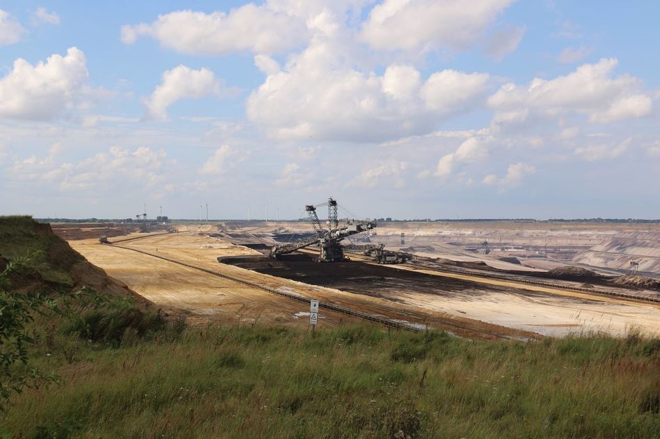 Brown coal surface mining - open cast coal mining. Huge bucket wheel excavator. new developed technology. Supposed to be more environmentally friendly. Bucket Wheel Excavator Calm Cloud - Sky Cloudscape Countryside Grass Landscape Nature Non-urban Scene Open Cast Coal Mining Outdoors Sky