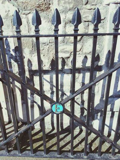 Shadow Day No People Outdoors Close-up Nature Sky Gate London Old Building Exterior Architecture Built Structure Metal Blue Letter Letter E Postcode Postcards