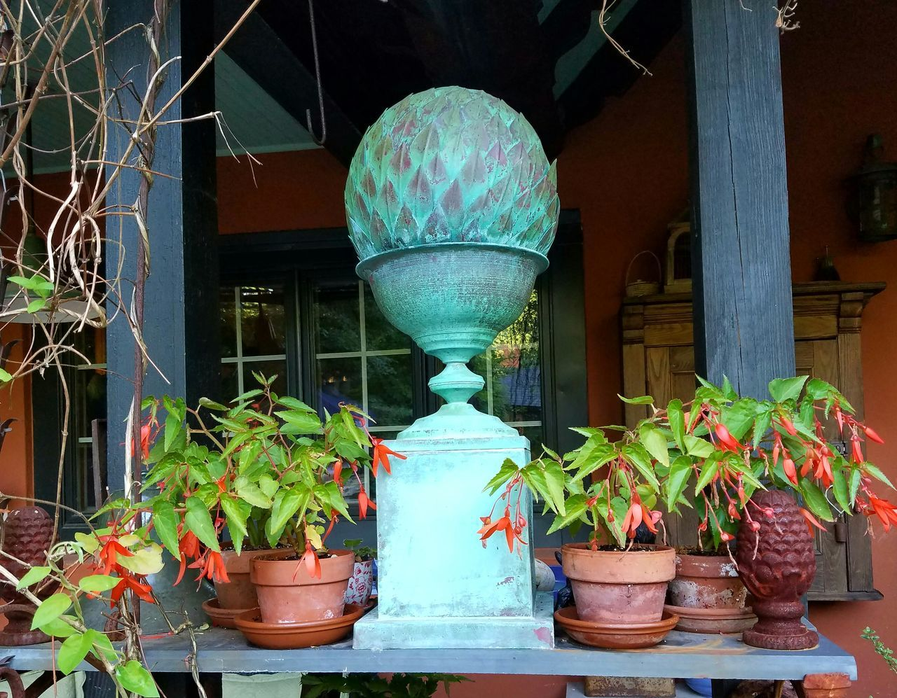 potted plant, plant, growth, leaf, no people, green color, architecture, built structure, outdoors, day, lantern, nature, building exterior, flower