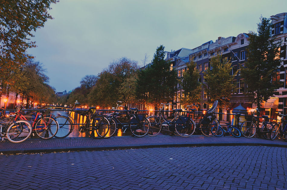 Beautiful stock photos of amsterdam, Horizontal Image, architecture, bicycle, bridge - man made structure