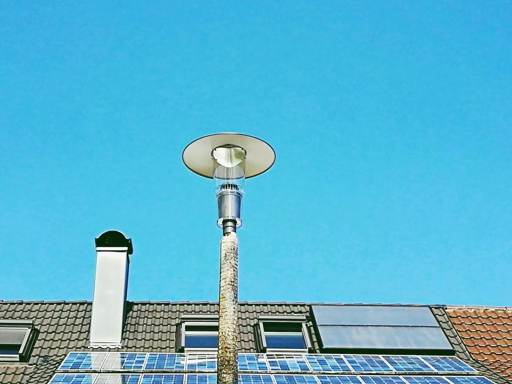 Alternative energy Blue Sky Low Angle View No People Clear Sky Outdoors Day Antenna - Aerial Architecture Alternative Energy Alternative Energy Elektric Power Solar Panel Solar Solar Systems Ecology Problem