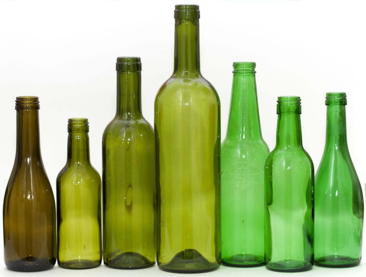 seven green bottles on white background Agriculture Alcohol Beer Bottle Bottle Cork - Stopper Drink Drinking Glass Food Food And Drink Green Color No People Wine Wine Bottle Winemaking Winery Winetasting