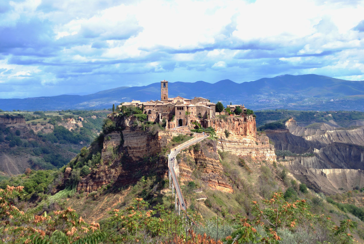 La Citta Che Muore Architecture Beauty In Nature Built Structure Civita Di Bagnoregio Cloud - Sky Day History Italy Lazio Mountain Mountain Range Nature No People Old City Outdoors Scenics Sky Spirituality Tranquil Scene Tranquility Travel Destinations Vacation Destination