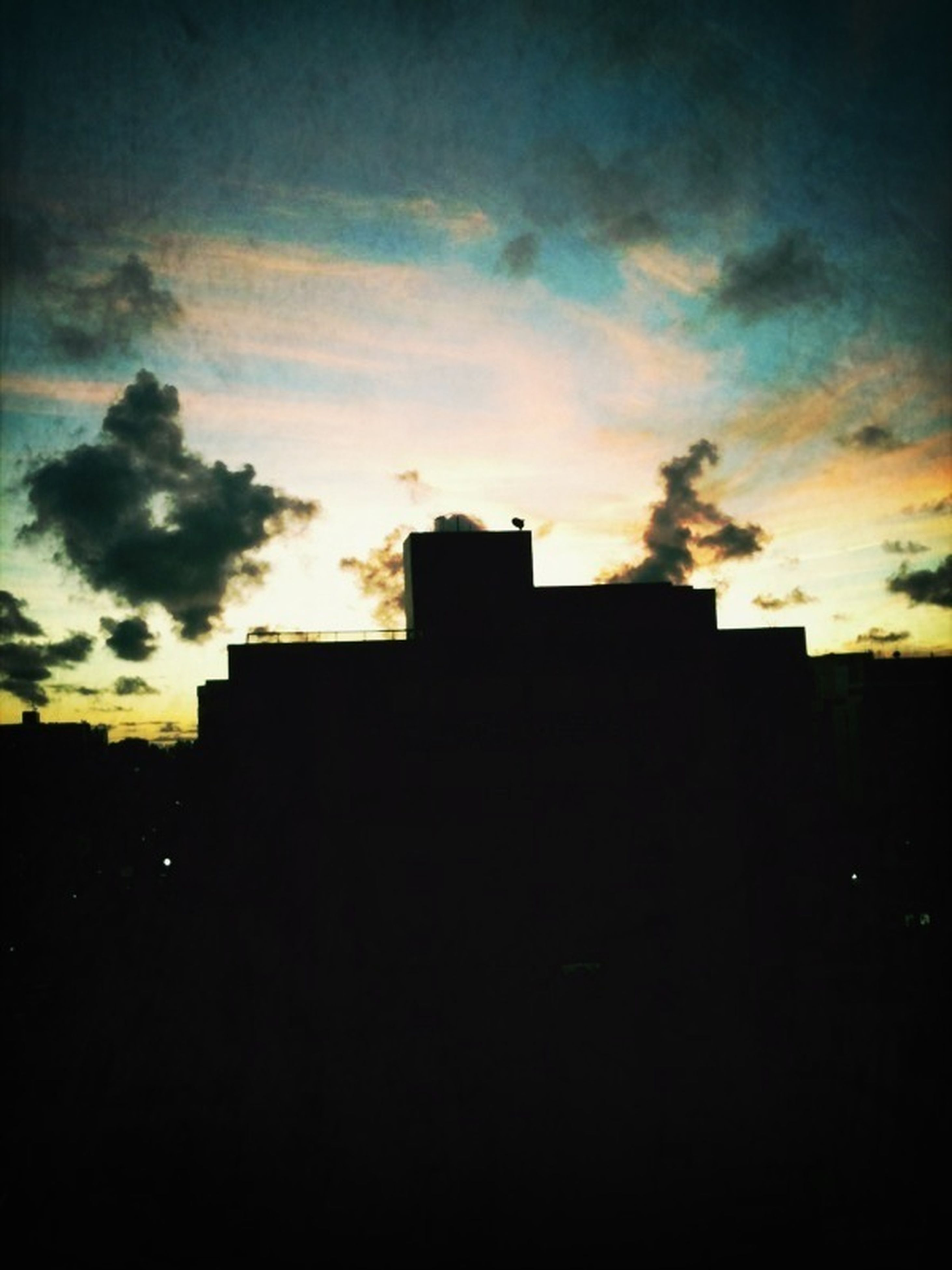 architecture, silhouette, built structure, building exterior, sunset, sky, low angle view, cloud - sky, dark, dusk, building, cloud, house, outdoors, outline, residential structure, no people, cloudy, orange color, dramatic sky