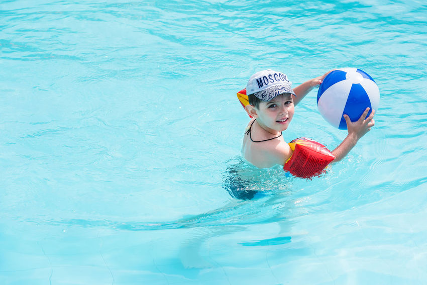 Trat, Thailand - May, 21, 2017 : Unidentified name Boys swimsuit floating and playing with ball in the swimming pool at Klong Prao Resort in Prao Beach Koh Chang island Trat, Thailand. Activity Ball Boy Cute Editorial  Float Floating Floating On Water Happiness Happy Illustrative Illustrative Editorial Lifestyle Pool Swimming Swimming Pool Thailand Water