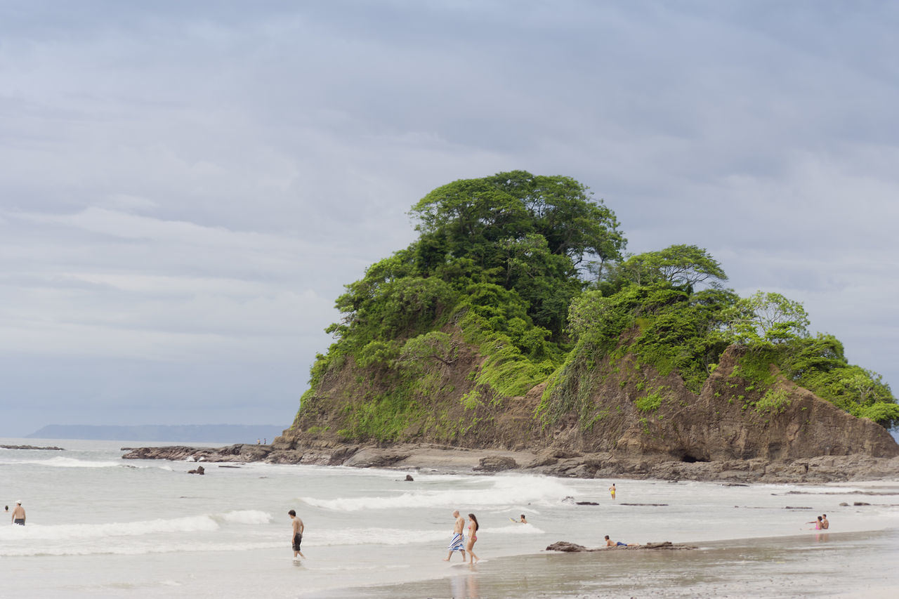 People at the beach in Punta Leona, Costa Rica Beach Beach Life Beach Photography Beachphotography Beauty In Nature Cliff Costa Rica Landscape Nature Pacific Ocean People Postcard Punta Leona Puntarenas Rock Formation Rocky Coastline Sand Scenics Sea Swimming Tourism Travel Destinations Vacations Water Young Adult