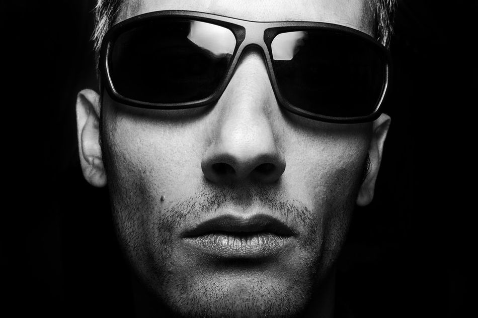 headshot of a man wearing sunglasses looking at the camera Adult Adults Only Black Background Blackandwhite Close-up Day Headshot Human Body Part Human Face Looking At Camera Men One Man Only One Person Only Men Outdoors People Portrait Real People Rock N Roll So Soft Light Studio Shot Sunglasses Young Adult Young Men