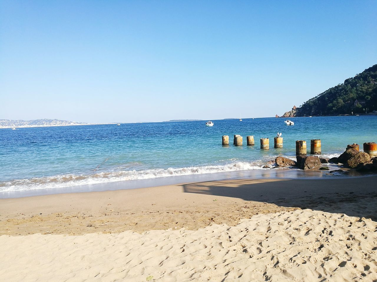 beach, sea, sand, water, shore, nature, clear sky, beauty in nature, scenics, tranquil scene, outdoors, blue, tranquility, horizon over water, day, no people, summer, sunlight, vacations, wave, sky