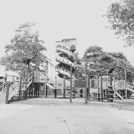 Playground Outdoor Play Equipment Outdoors Monkey Bars Slide - Play Equipment Childhood No People Tree Day Jungle Gym Sky Seesaw Classic Memories Childhoodmemories Black And White Photography Black & White No Logo No Logos City Focus On Foreground Outdoor Photography Outdoor Art Children Photography Child