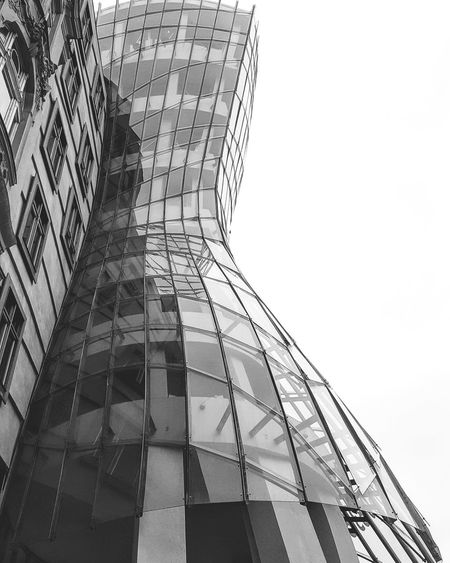 Low Angle View Architecture Sky Built Structure Outdoors City No People Day Skyscraper Close-up Desaturated