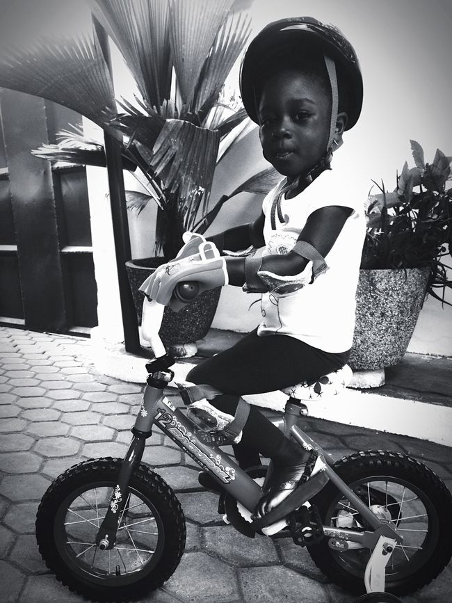 Full Length Casual Clothing Childhood Sitting Lifestyles Holding Leisure Activity Bicycle Land Vehicle Person Riding Innocence Front View Unknown Gender Person Young Adult Person Day Baby Clothing