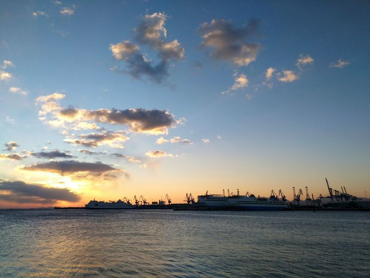 YanTai Port in China Sea Water Cloud - Sky Sky Blue No People Beauty In Nature Travel Destinations Horizon Over Water Nature Outdoors Sunrise Ship At Dock Container Cargo Ship Twilight Business Finance And Industry Transportation Trade Export Products