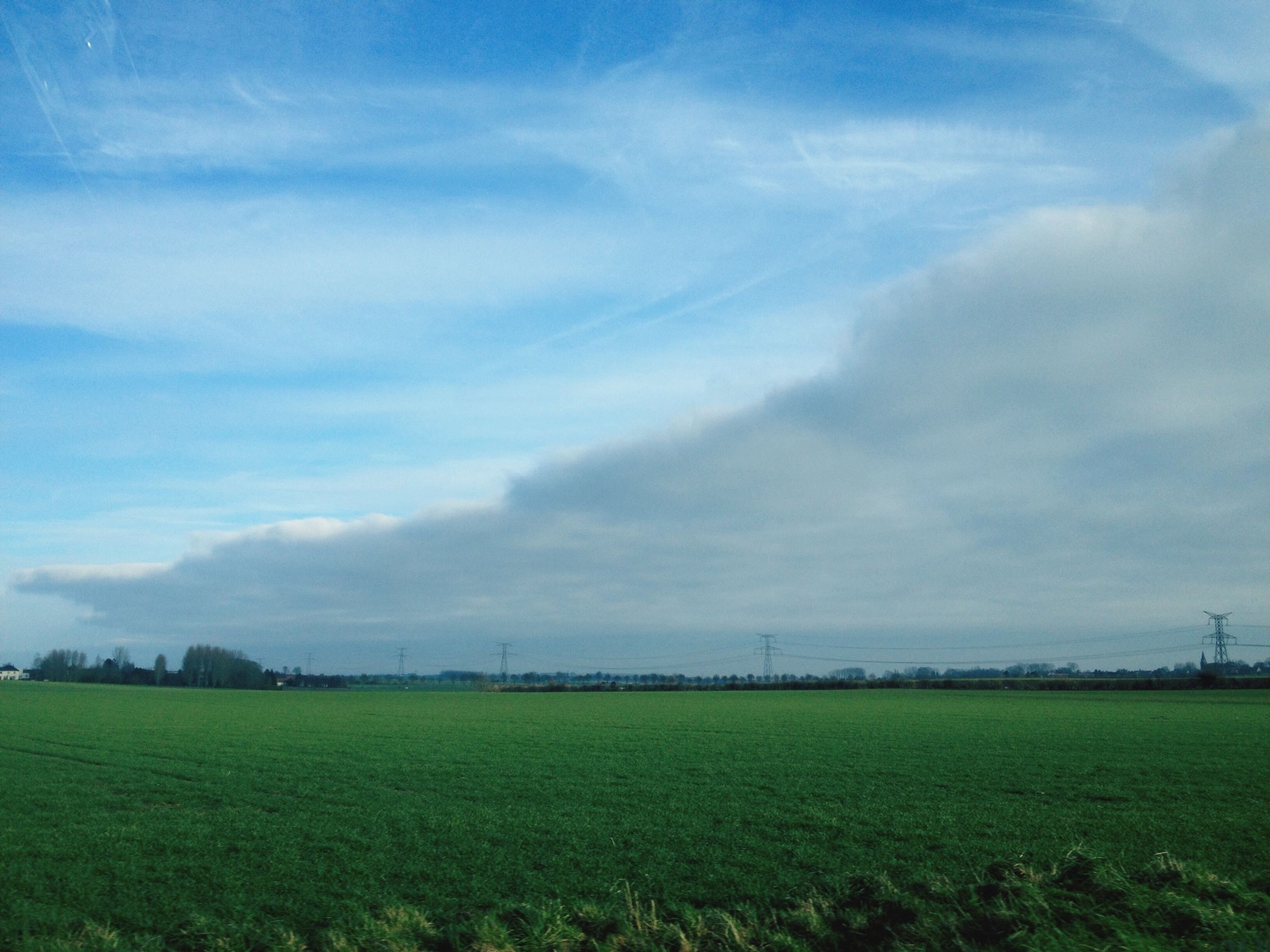 field, landscape, grass, sky, tranquil scene, tranquility, green color, scenics, beauty in nature, nature, rural scene, cloud - sky, grassy, agriculture, growth, cloud, farm, cloudy, blue, idyllic