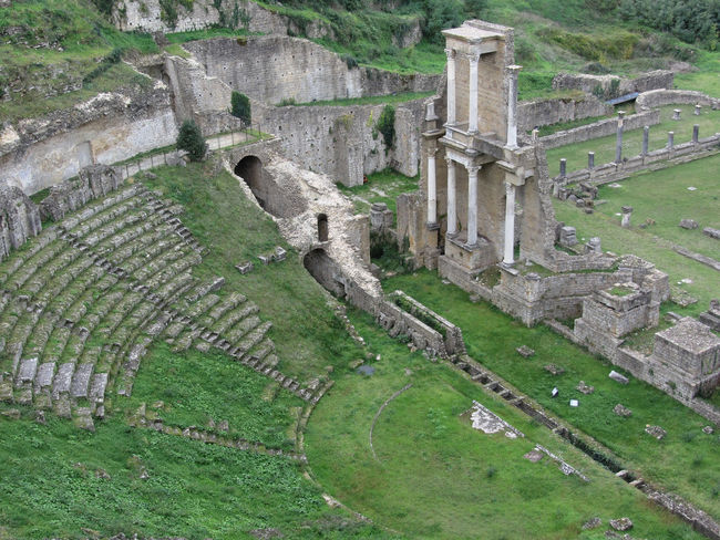 Ruins of a antique roman amphitheater in Volterra, Province of Pisa, Tuscany, Italy Aerial Amphitheater Ancient Antique Archaeology Architecture Auditorium Civilization Columns Culture Empire Excavation Historic Italy No People Pisa Roman Ruins Theater Theatre Tourism Travel Tuscany View Volterra