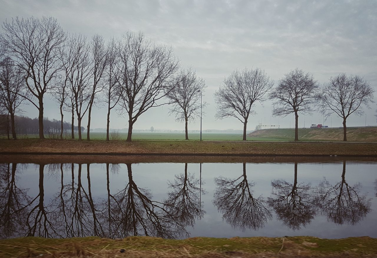 Tree Nature Sky Water Landscape Cloud - Sky No People Capture The Moment EyeEmBestPics Snapspeed Eye4photography  Sgs7edge Treescollection Trees Drivebyphotography Reflection Reflection_collection Reflections In The Water On The Road At Work Kanaal Den Bosch Tranquility Outdoors Beautiful Day
