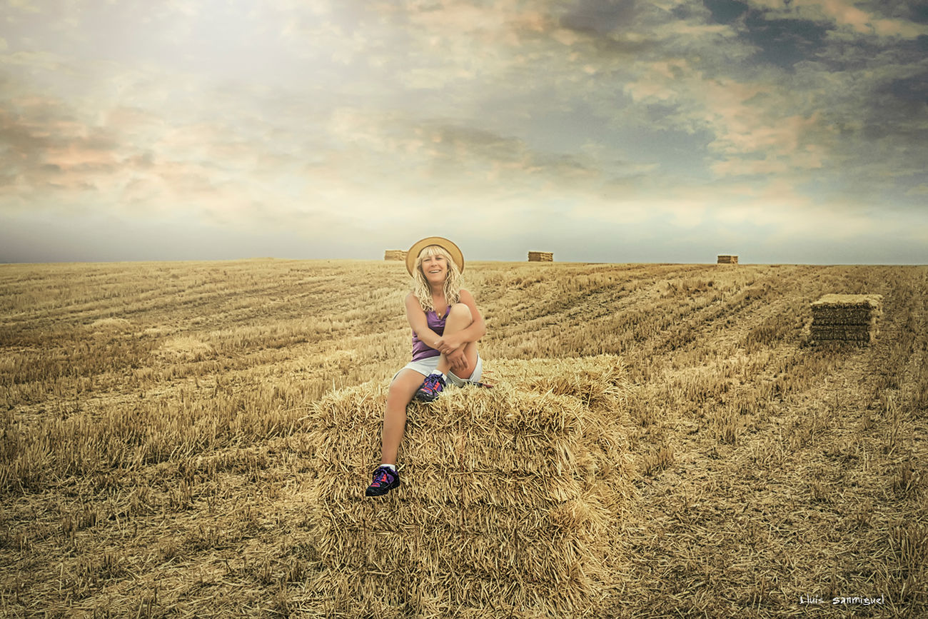 Blonde woman among wheat straw Adult Blond Hair Cereal Plant Day Field Live For The Story Nature One Person One Woman Only One Young Woman Only Outdoors People Portrait Rural Scene Sky Wheat Young Women