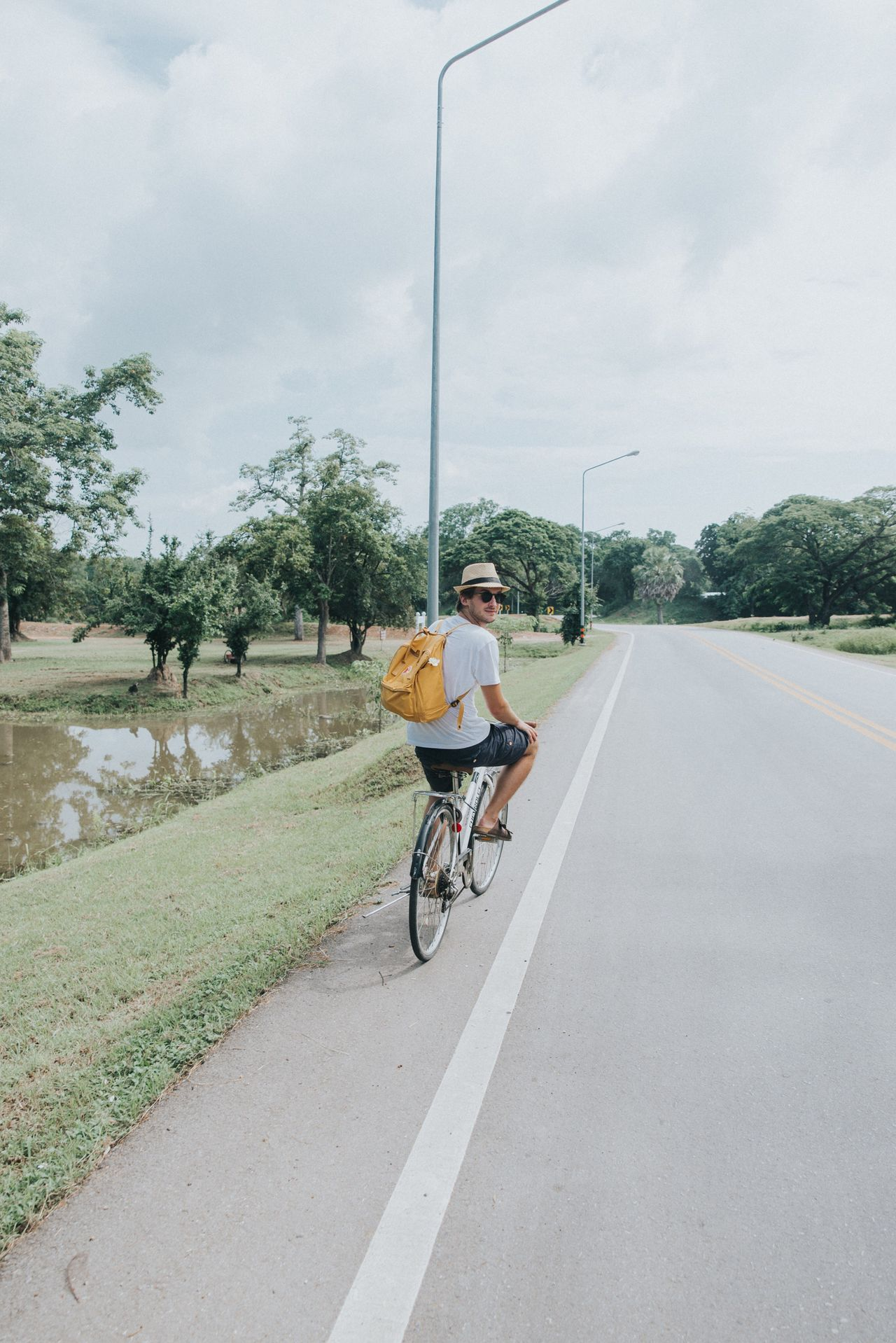 Thailand 🇹🇭 biking around Sukhothai during our honeymoon trip. You really want to go there and intentionally get lost in this historical site and wait for the golden hours to learn the true meaning of magic ✨EEyeEm GallerytTravel DestinationsfFull LengthbBicycleoOne PersonTTransportationcCyclingmMode Of TransportrReal PeopleoOutdoorsyYoung AdultEEyeEm Best ShotsEEyeEm Best EditsEEyeEmBestPicsTThailandLLive For The StoryLLive For The Story