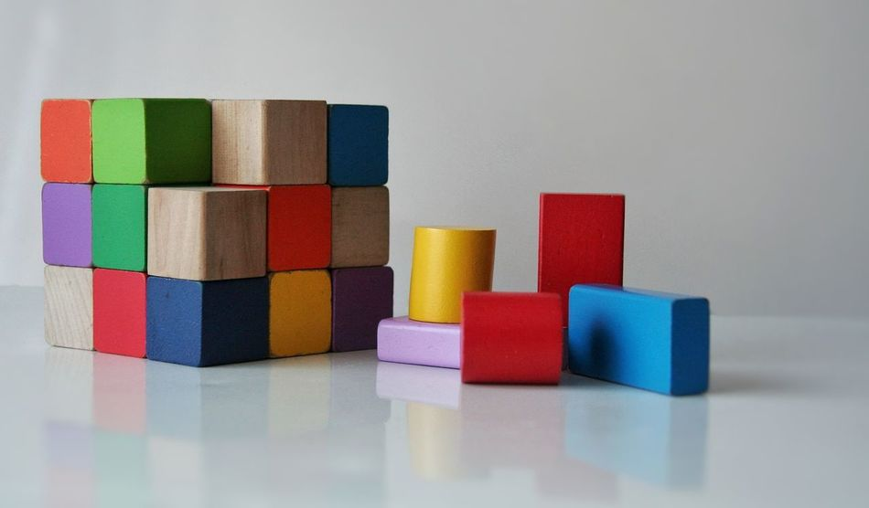 Wooden Toy Block Large Group Of Objects Close-up Multi Colored No People Creative Childs Childs Toy Business Finance And Industry Cube Stack Childhood Red Blue Yellow White Background Forms And Shapes