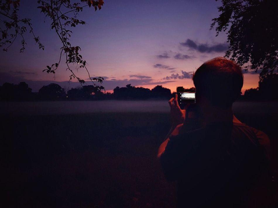 Sunset Digital Camera Silhouette Beauty In Nature Photographer One Person Men Tree Sky Purple Sky Night Nightphotography Leisure Activity Fog Foggy Purple Nature Mobilephone Smartphone Boy Evening Field Summer Teen Feelings TCPM Art Is Everywhere Break The Mold