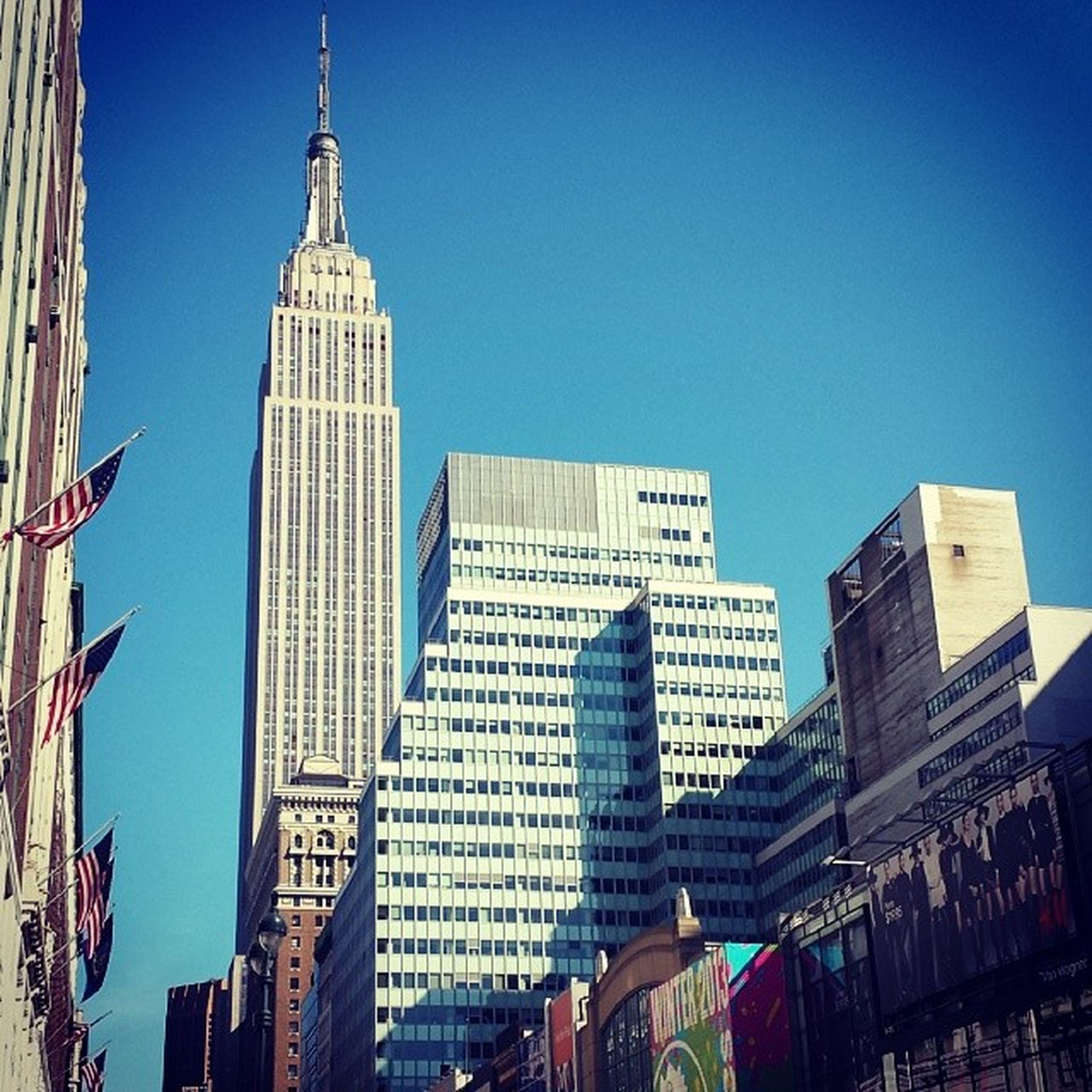 building exterior, architecture, built structure, clear sky, skyscraper, low angle view, tall - high, tower, city, modern, office building, blue, copy space, building, tall, capital cities, city life, financial district, travel destinations, outdoors