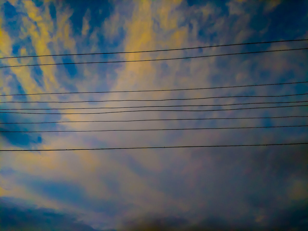 low angle view, sky, cloud - sky, cable, power line, no people, outdoors, nature, connection, power supply, blue, beauty in nature, electricity, day