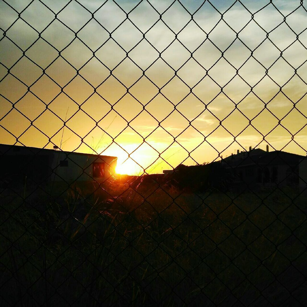 Sunset Protection Security Fence Safety Chainlink Fence Sunset Tranquil Scene Landscape Tranquility Silhouette Solitude Sky Sun Idyllic Calm Scenics Remote Dark Outline Atardecer Pueblos De España Village Life