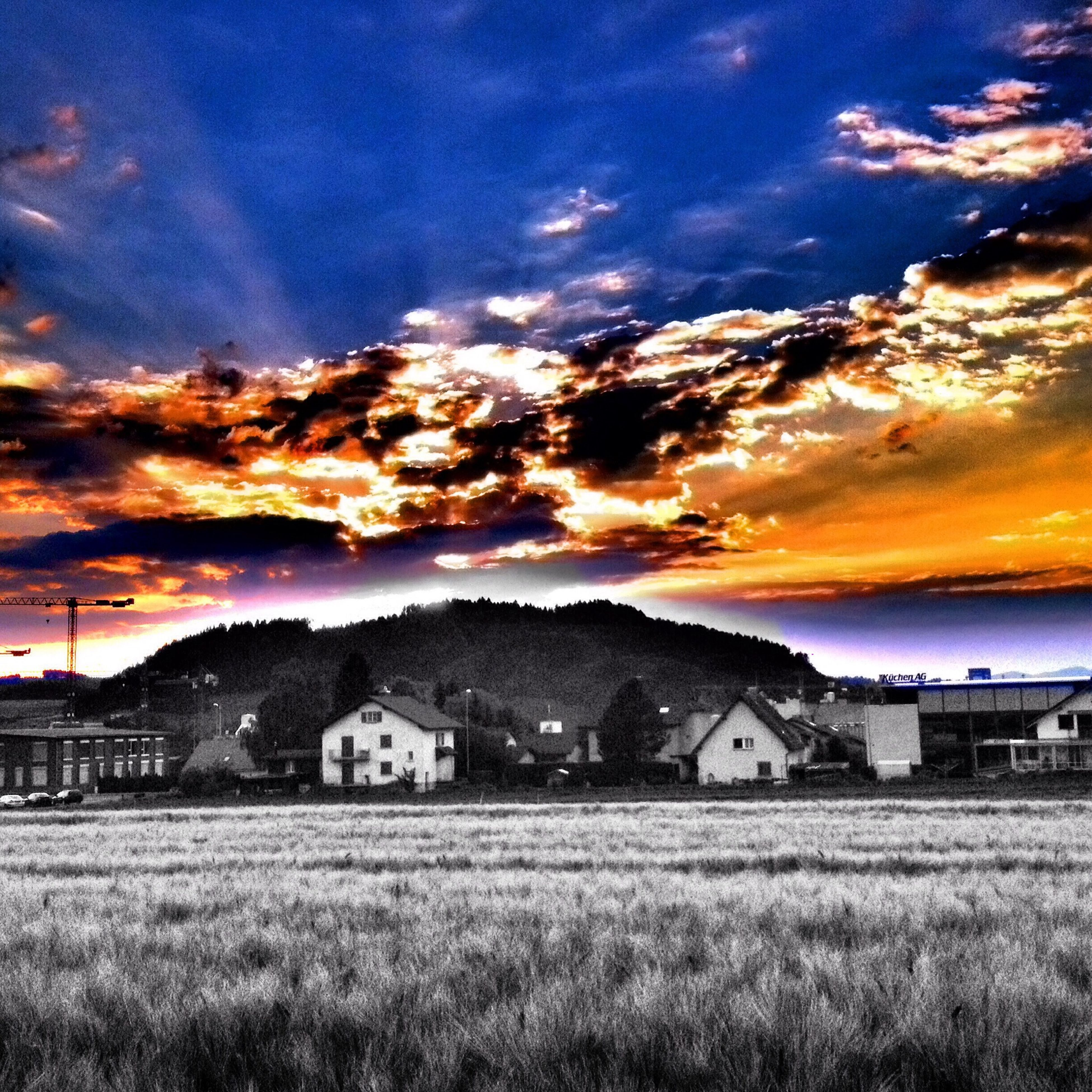 sunset, sky, building exterior, landscape, field, cloud - sky, architecture, built structure, orange color, house, scenics, beauty in nature, tranquil scene, rural scene, dramatic sky, tranquility, nature, grass, cloud, cloudy