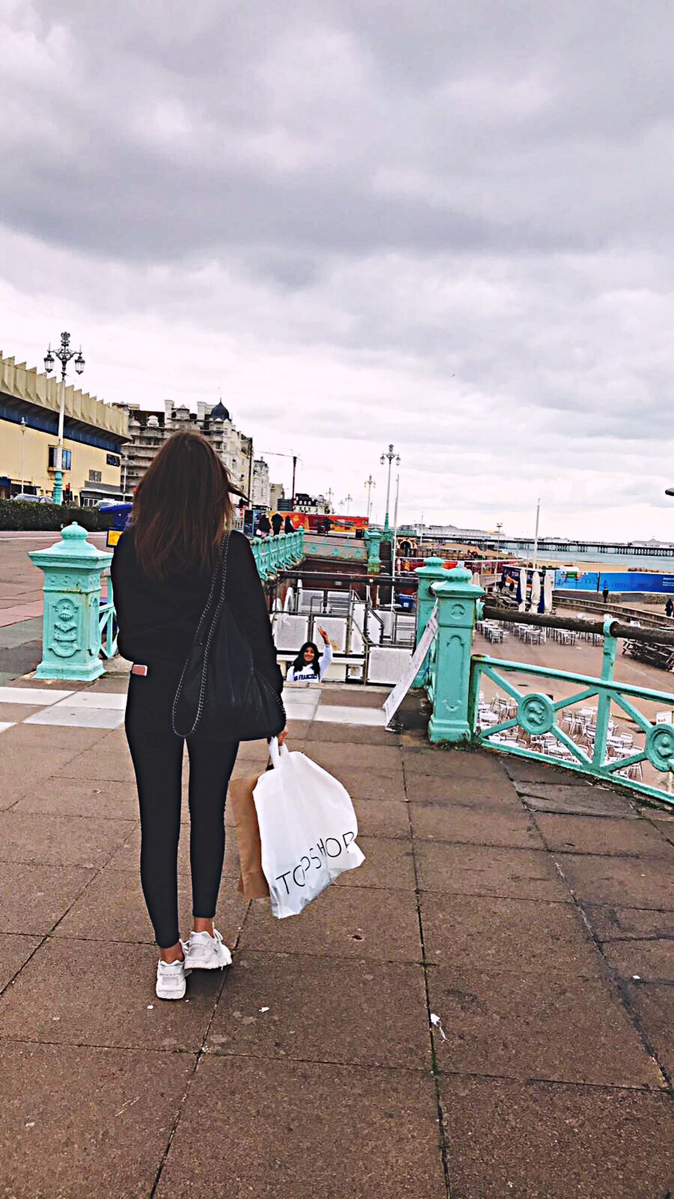 full length, sky, rear view, cloud - sky, standing, person, casual clothing, cloud, city, sea, togetherness, day, water, cloudy, ocean, harbor, jetty, outdoors