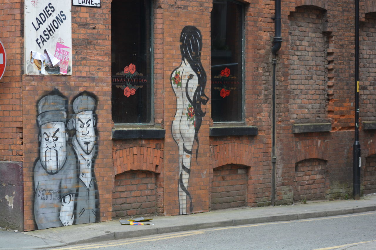 art and craft, human representation, creativity, architecture, built structure, male likeness, building exterior, day, graffiti, text, statue, sculpture, outdoors, no people