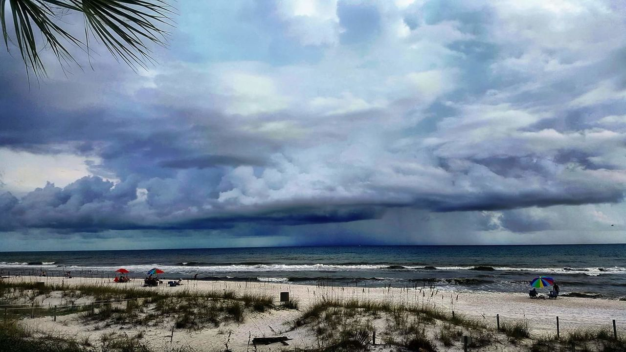 Sea Beach Storm Cloud Cloud - Sky Nature Water Thunderstorm Dramatic Sky Outdoors Scenics Beauty In Nature Storm Vacations Sky Horizon Over Water People Day