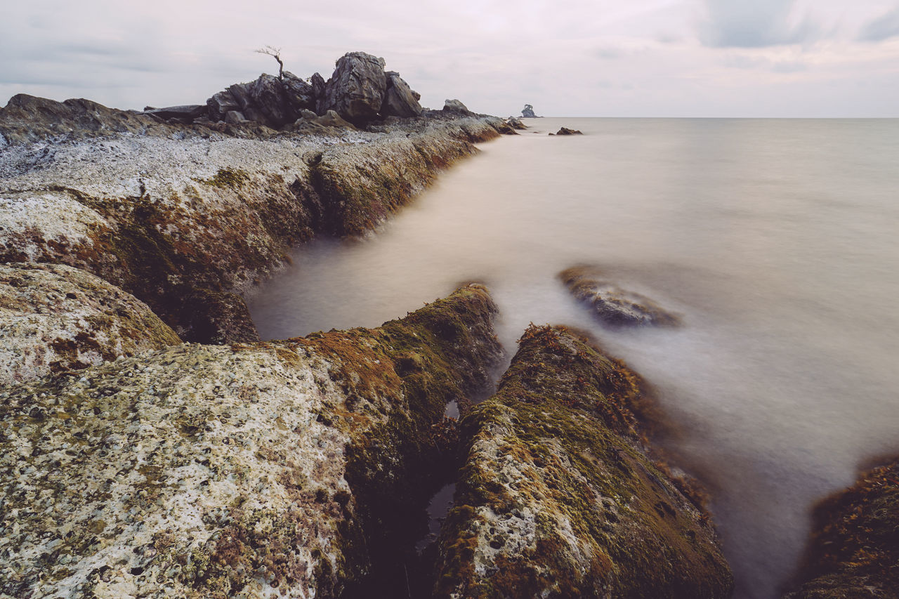 water, nature, beauty in nature, scenics, rock - object, rock formation, tranquil scene, sea, sky, tranquility, no people, outdoors, motion, long exposure, cliff, horizon over water, day