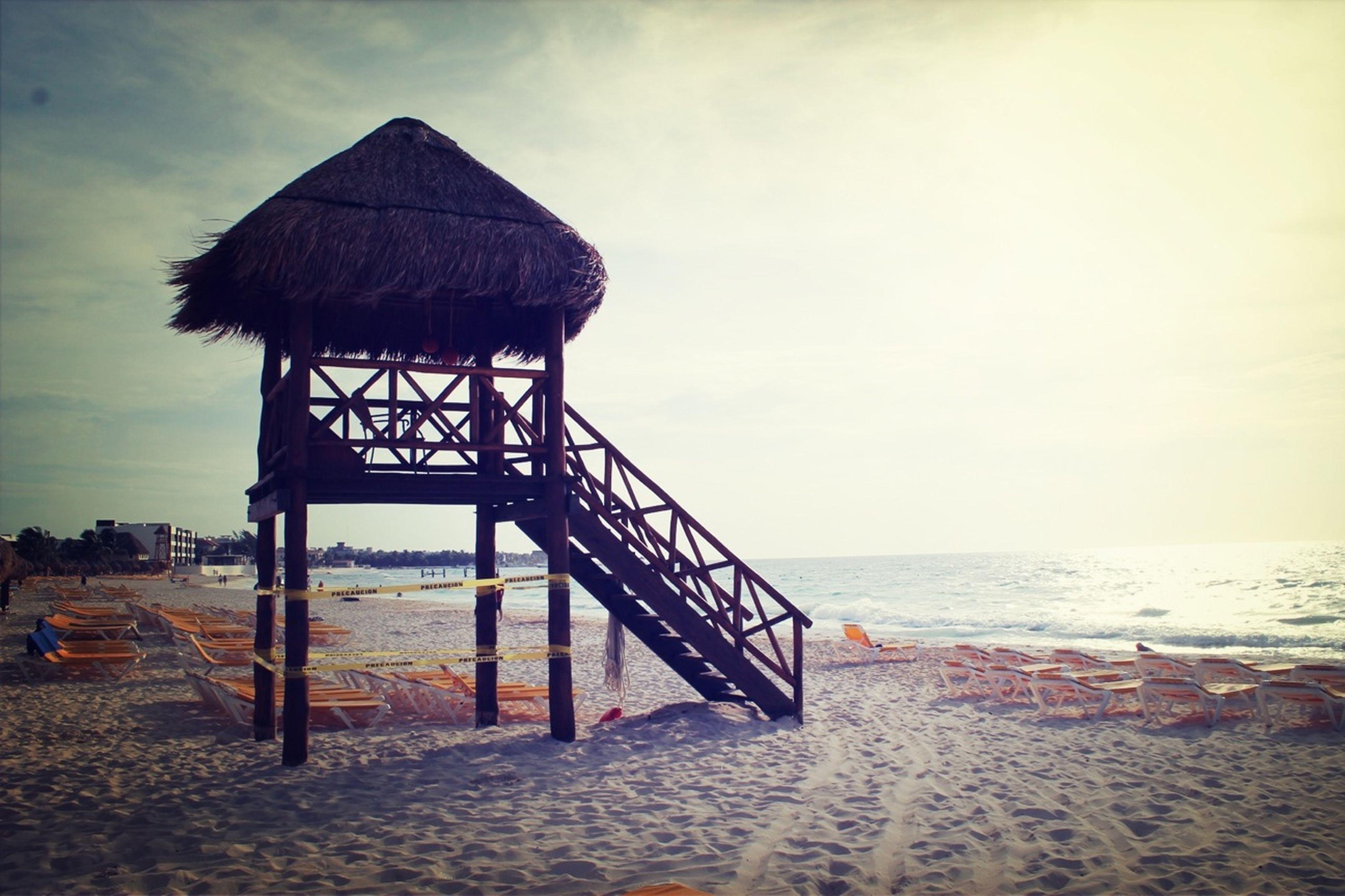 beach, sea, horizon over water, sand, shore, water, tranquility, sky, tranquil scene, scenics, nature, beauty in nature, idyllic, vacations, remote, pier, non-urban scene, coastline, ocean, outdoors