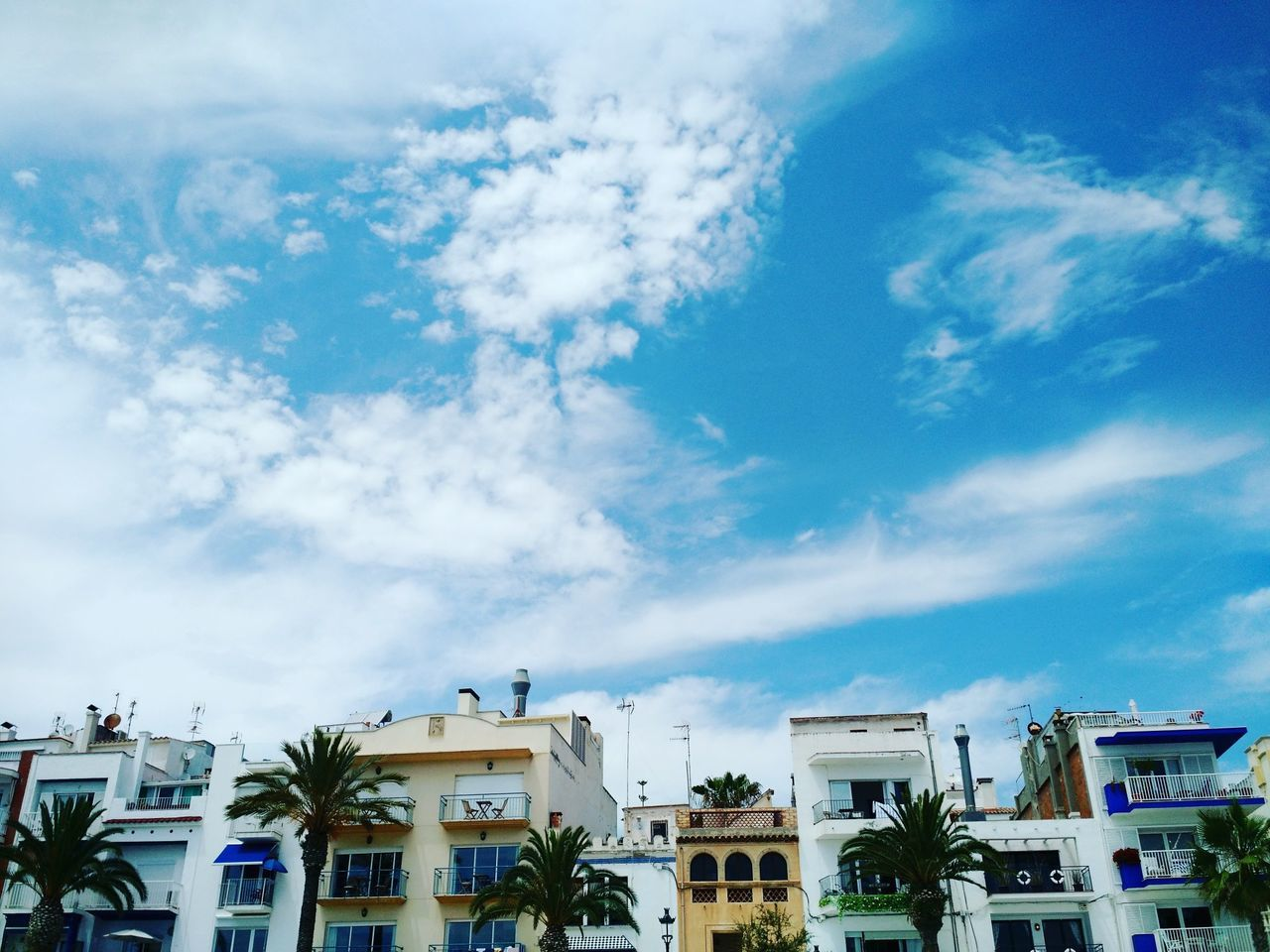 Cloud - Sky City Building Exterior Sky Travel Destinations Architecture Built Structure No People Outdoors Day Sitges Barcelona España Clouds And Sky Beauty In Nature Landscape Spainish Architecture, Spain Exquisite Architecture Places To See